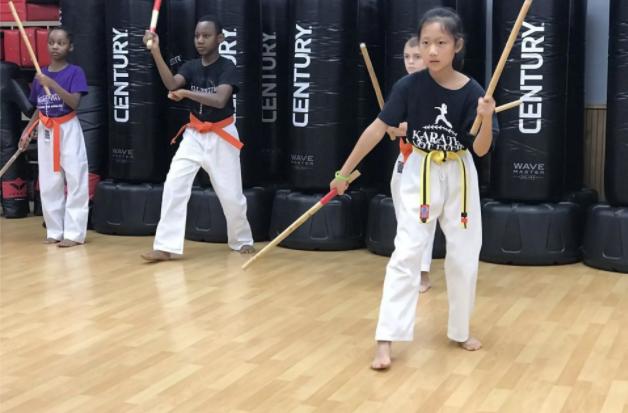 Karate Students Practicing Sticks Kobudo